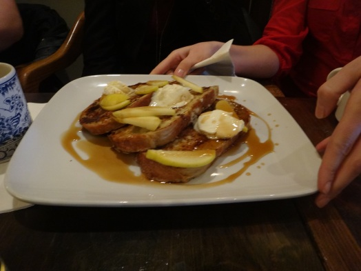 Monika chose the Challah French Toast for her meal, drenched in maple syrup. Yum!