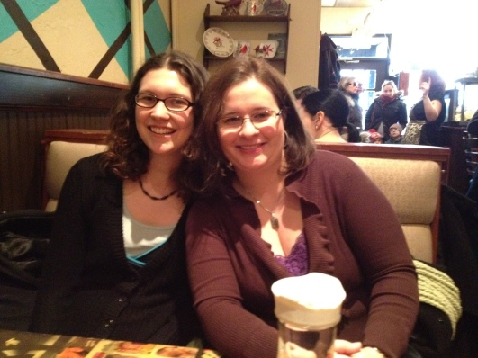 KT and Linds sitting down at our booth at Cardinal in Toronto for brunch