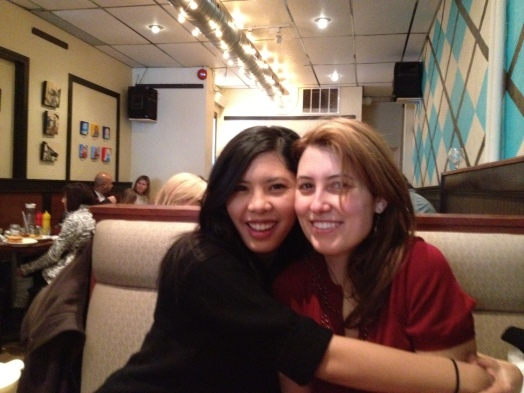 Monnie and Me sharing a hug during brunch at Cardinal Rule