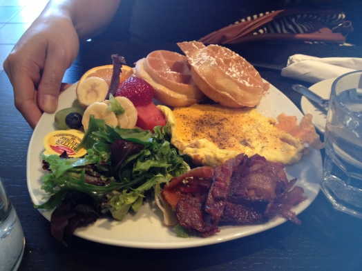 The Hitchhiker: The Kitchen Sink of Brunches - It has everything salad, waffles, bacon, eggs and fruit salad