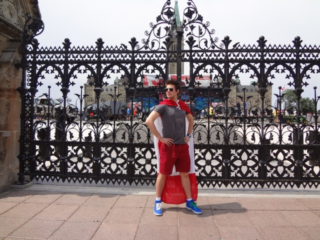 Captain Canada standing in front of the gate