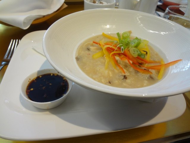 chicken and ginger congee shredded chicken and shiitake mushrooms congee truffle chili soy drizzle AGO Frank